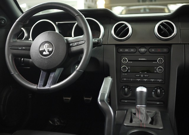 https://selectluxury.files.wordpress.com/2010/04/2008-ford-mustang-shelby-gt500-convertible-steering-wheel-and-dash-view.jpg